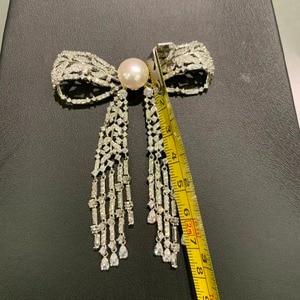 Image 5 - 11 12 ミリメートル天然淡水真珠のブローチ銅立方ジルコンちょうブローチピンタッセル古典的なファッション女性ジュエリー
