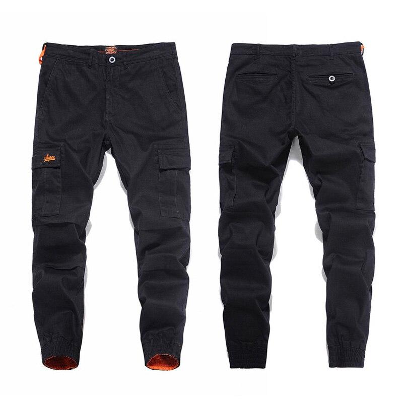 Nouveauté mode hommes Jeans pantalons de survêtement Slim jambe ouverte couleur noire Denim cheville bandé Jeans hommes marque grande poche Cargo pantalon