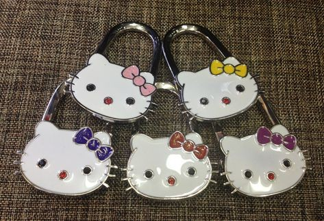 194fbd3fca6f Free Shipping New hello kitty bag holder Women Folding Handbag Hanger Hook  Bag Purse Holder bolsos Gift-in Bag Parts   Accessories from Luggage   Bags  on ...