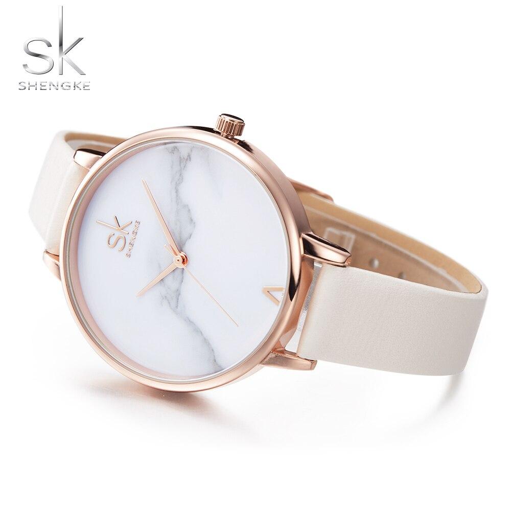 Shengke Top de moda de la marca de relojes elegante mujer reloj de cuarzo de mujer, correa de cuero reloj Montre Femme mármol marcar SK
