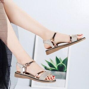 Image 3 - STQ Sandalias planas de goma para mujer, zapatos de tacón bajo para playa, estilo Gladiador, color negro y dorado, YY366, 2020