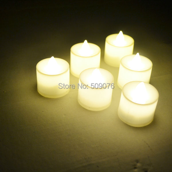 Free shipping 24pcs/lot Flameless Flicker Battery Operated LED Tea Lights Candles warm White Wedding Xmas Party