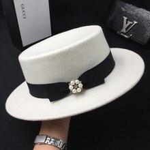 Sombrero de invierno para mujer Lana blanco nuevo bowknot gorra plana  perlita sombrero de fieltro cd95c882262