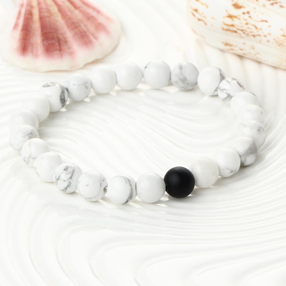 Bracelet de perles blanc et noir en howlite blanche et onyx