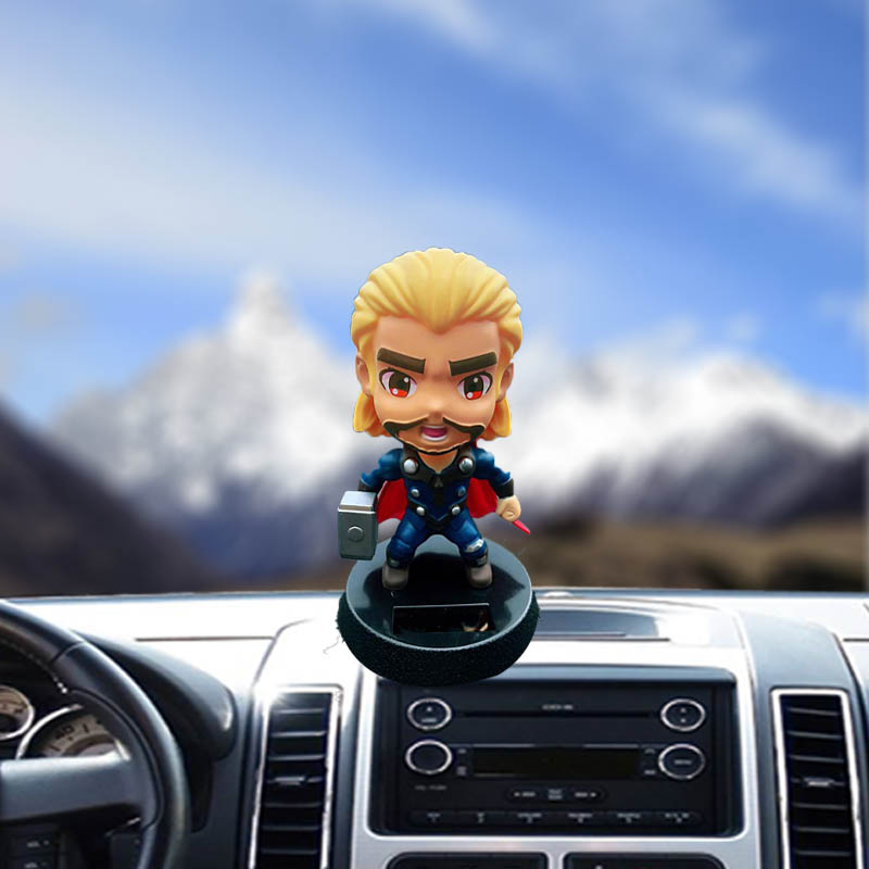 Car interior decoration accessories resin material creative solar animation doll shaking head gifts new cartoon car ornaments