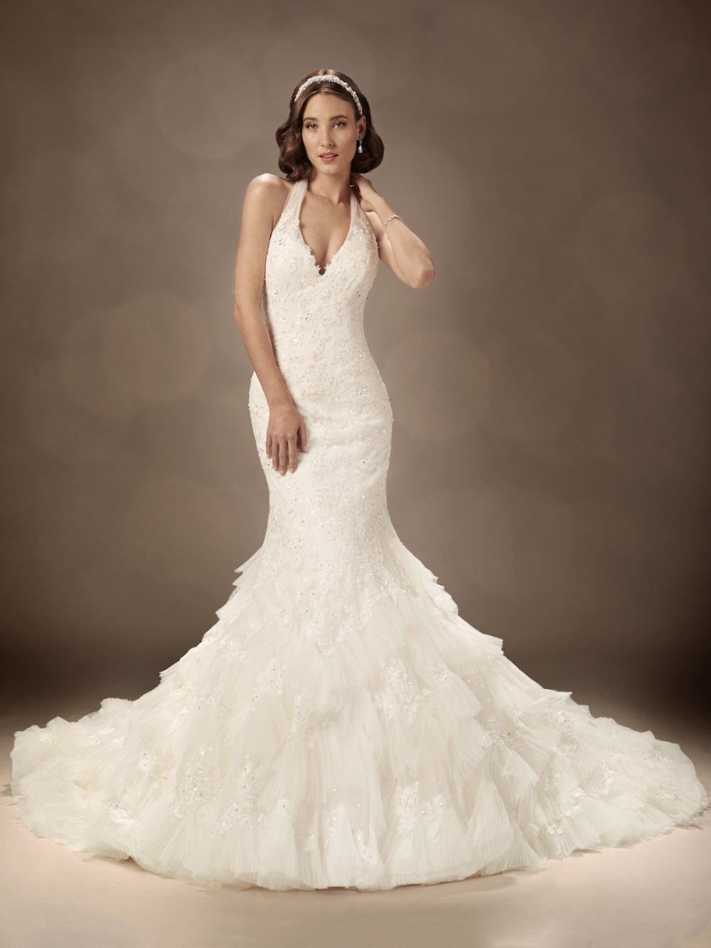 Romance mermaid silhouette wedding gown and plunging halter neckline ...