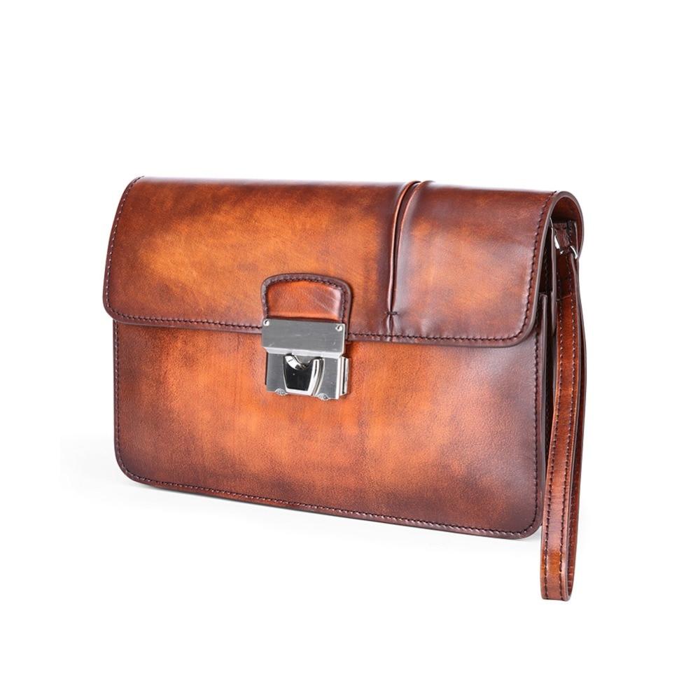 c5ec3b8cd3c7 TERSE 2017 nouvelle version hommes faits à la main d embrayage sac document  hommes portefeuille orange de luxe en cuir véritable bureau sac logo ...