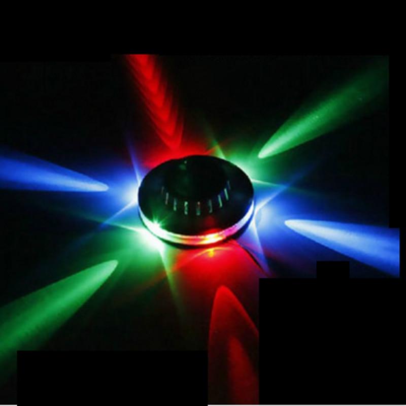 где купить Sound Activated Revolving UFO LED Music Laser Stage KTV Bar Party Wedding Club Projector Light по лучшей цене
