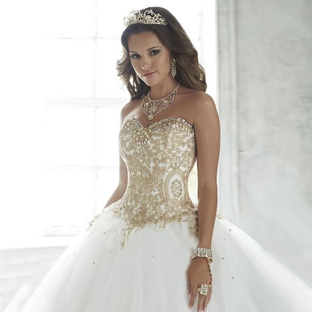 Robe de mariee blanche et or