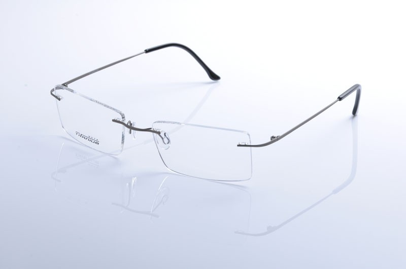 d65880f89 Moda homem mulheres sem aro titanium armações de óculos de lente ...
