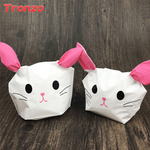 Buy cute gift wrapping and get free shipping on aliexpress tronzo 50pcsset easter gift bags cute rabbit black bear pink cat ear bags happy negle Images