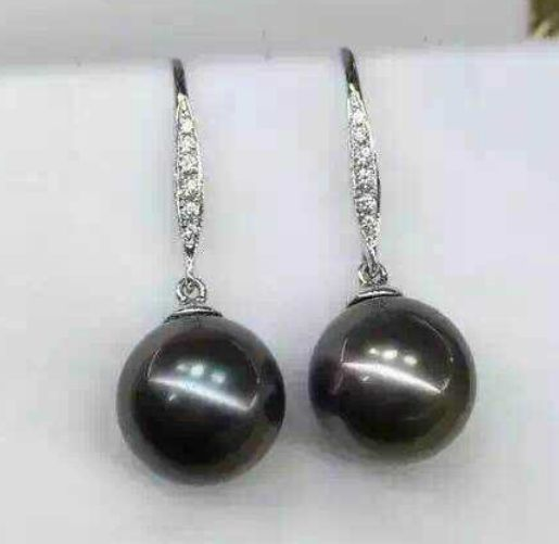 a pair of tahitian black pearl earrings silver