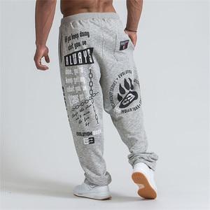 Image 2 - 2019 novos homens joggers cor sólida calças esportivas calças de ginásio de algodão elástico calças compridas homens rendas calças esportivas masculinas leggings