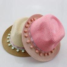 Nuevos niños de Jazz sombreros de verano sombrero de paja niños viajes  estilo nacional sombrero borla bolas playa muchacho Retro. 0090b74f2e2