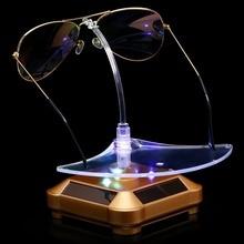 купить Solar energy display table rotating table glasses display frame rotating table glasses ornaments frame glasses shop window displ по цене 1201.17 рублей