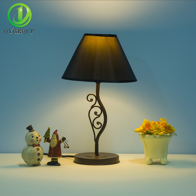Modern desk lights fabric chimney iron lamp body twisting shape modern desk lights fabric chimney iron lamp body twisting shape new table lamp living room decoration mozeypictures Gallery