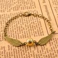 Sol del estilo de la vendimia del ala del ángel del encanto feliz potter snitch dorada colgante pulsera para hombres mujeres reloj steampunk quidditch wing