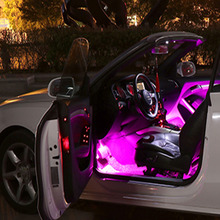 Automobile interior ambient lamp refitted with LED foot sole USB car trim sound control