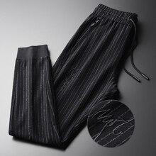 Minglu primavera calças masculinas plus size 4xl moda fio tingido listras verticais calças masculinas cintura elástica bordado calças magras