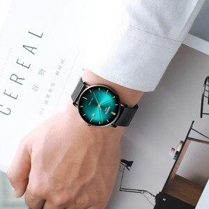Image 5 - NIBOSI 男性トップの高級超薄型日付時計男性ブルースチールメッシュストラップビジネス · スポーツクォーツ腕時計男性時計
