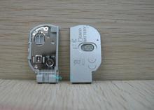 Originale per Nikon L20 Batteria Porta Coperchio Della Batteria Cap Coperchio di Riparazione Della Macchina Fotografica Parte argento