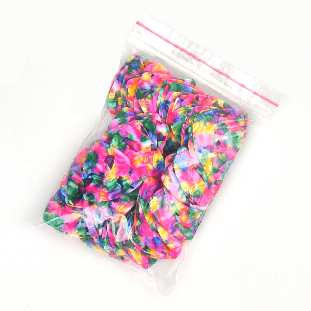 Купить с кэшбэком Lots of 100 pcs Rounded Triangle Big Size Medium 0.71mm Celluloid Guitar Picks Tie-dye