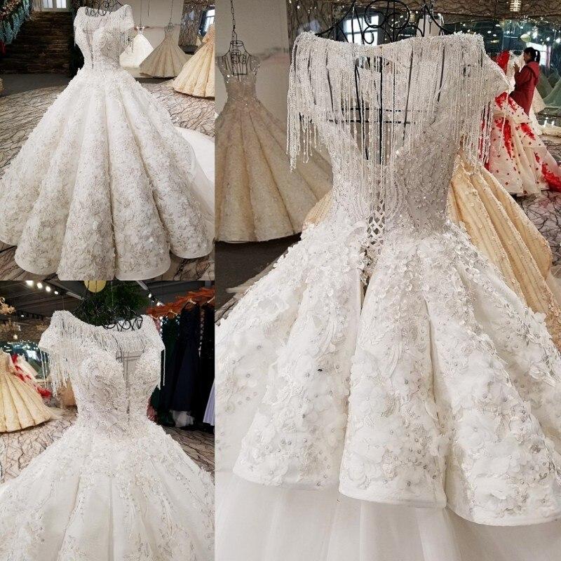 2018 Spring Xia Xinkuan Korean Package Shoulder Long Sleeve Bride Luxurious Self-cultivation Tailing Wedding Dress Full 65416