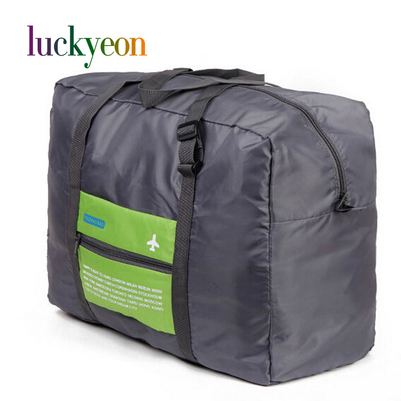 Moda bolsa de viaje a prueba de agua Bolsa de gran capacidad Mujeres Hombres Nylon Bolsa plegable Unisex Equipaje Bolsos de viaje