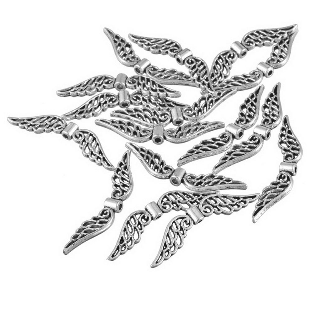 50pcs Silver Angel Wing Spacer Beads Tibetan Retro DIY Jewelry Pendant  32x7mm For Jewelry Making image 374c9ab6772a