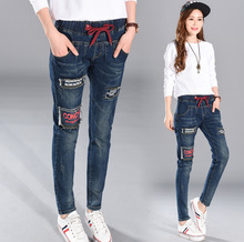 2016 Factory direct supply of a fat on behalf of the fat mm autumn jeans plus fat plus size ladies loose Harlan feet pants T37