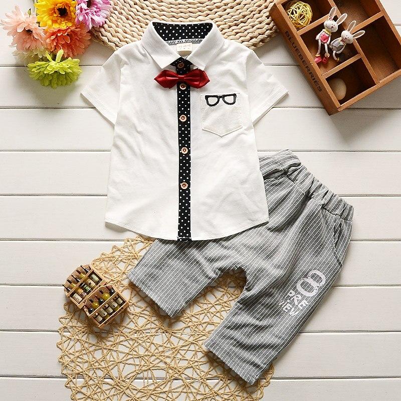Los niños de los bebés ropa del verano fija los cabritos del algodón sólido ropa