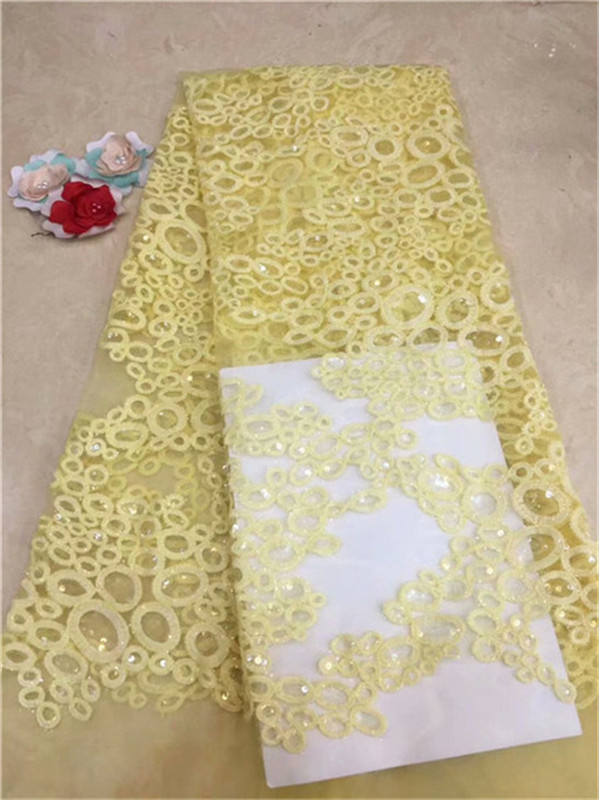 Latest design african cord lace fabric yellow high quality french tulle lace fabric with sequins embroidered net lace fabric