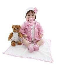 Bebé de 55 cm con trajecito rosa