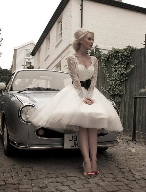 Hot Sales Lace Vintage Short Wedding Dresses Long Sleeve Black Sash Tea  Length Garden Bridal Gowns Custom Made with Black Flower 237761a4dfd7