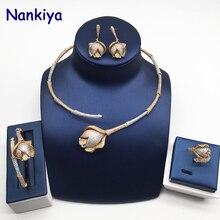 Купить с кэшбэком Nankiya Luxury Bamboo Knot Rose Flower Africa Jewelry Set Clear CZ 3 Tone Gold Women Party Dubai 4pcs Jewellery Set NC739