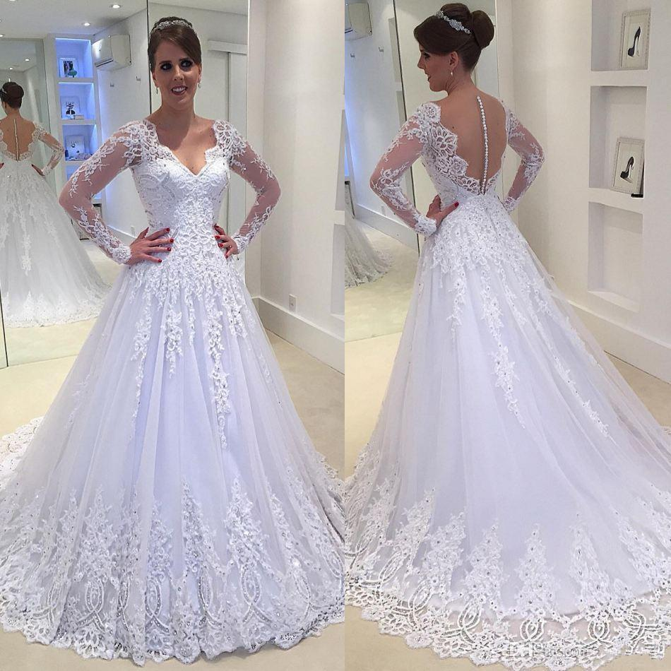 2017 Sexy See Through Button Back Wedding Dresses Vestios De Novia V neck Sheer  Long Sleeves Lace Appliques Beaded Cheap Bridal -in Wedding Dresses from ... ce1d1e81c