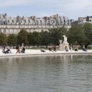Tourists in a garden  Jardin de Tuileries  Musee Du Louvre  Rue de Rivoli  Paris  Ile-de-France  France Poster (24 x 14)
