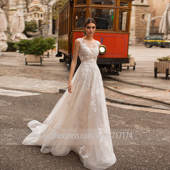 Scoop Tulle Neckline Sleeveless A-line Wedding Dress with Fashion Lace Applique Illusion Button Back Court Train Bridal Dress