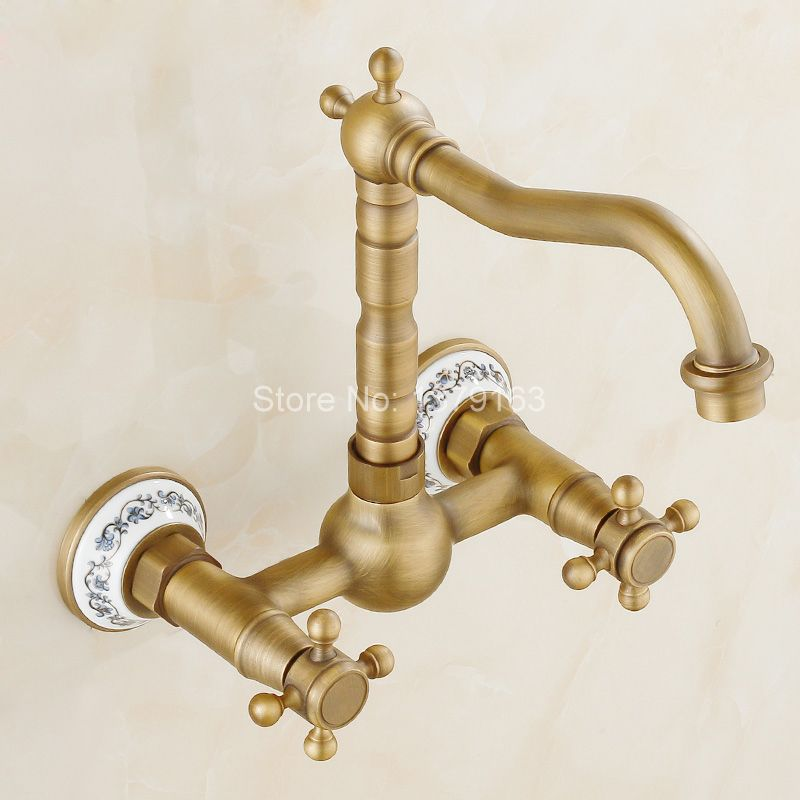Antique Brass Ceramic Base Wall Mounted Dual Handles Swivel Spout Kitchen Sink Bathroom Basin Faucet Cold & Hot Mixer Tap aan023 solid brass antique brass bathroom basin faucet swivel spout wall mounted mixer