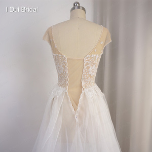Image 5 - Cap Sleeve Sparkle Wedding Dress with Organza Ruffles Illusion Neckline Shinny Bridal Gown