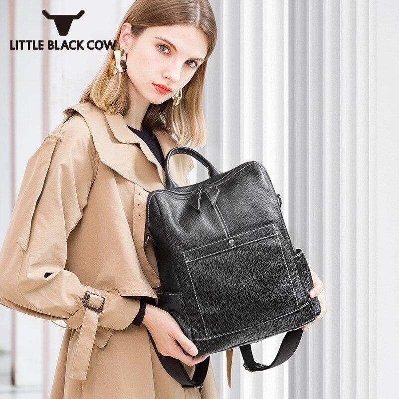 Double usage sac d'école étanche en cuir de vache tout nouveau Zipper grand sac à dos noir ordinateur voyage sac à dos femmes de haute qualité