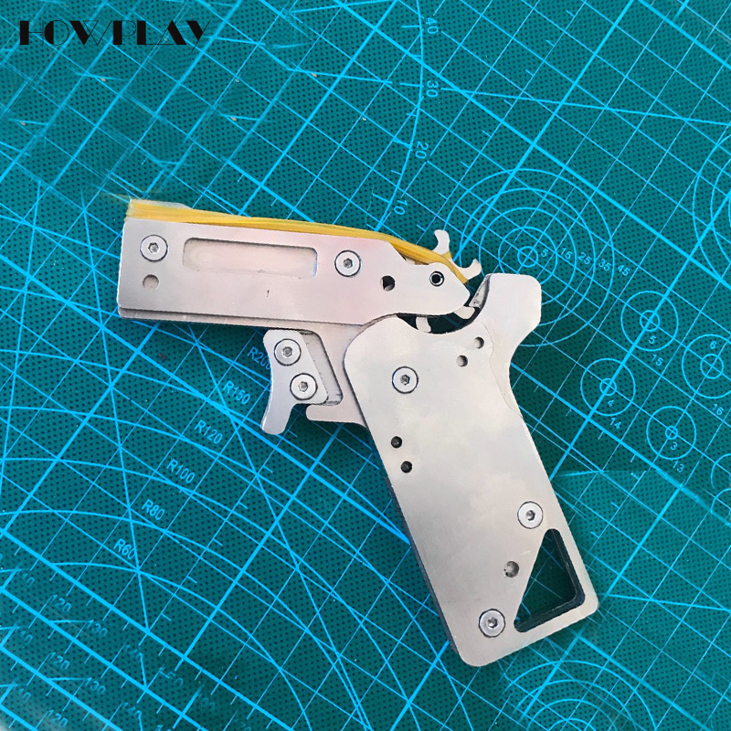 HowPlay Metal Mini rubber band Gun Folding 6 bursts Of Bullets toy guns Shoot toy gun boy toy Outdoor toys pistol gun gift mini wrist squirt water gun gaming toys for outdoor