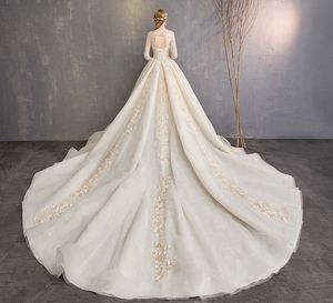 Image 2 - Walk Beside You Champagne Wedding Dresses Lace Applique Beaded Ball Gown Cathedral Train Three Quarter Sleeves Bridal Gowns Long
