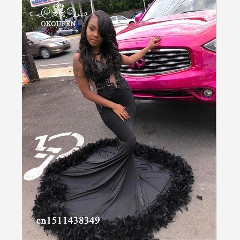 Robe de soirée noire chapelle Train avec plume 2019 dentelle Appliques Long transparent bijoux cou sirène robes de bal pour les femmes