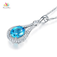 Peacock Star 14K White Gold 2.5 Ct Oval Swiss Blue Topaz Pendant Necklace 0.26 Ct Diamond