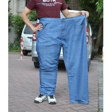 Бесплатная доставка 2016 новинка мужские джинсы для толстый человек свободного покроя джинсовые брюки промывают синие джинсы мужские Большой размер 38 — 48