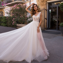 Waulizane Tulle And Organza Puffy Skirt Beach Wedding Dress With Backless Of Natural Waistline