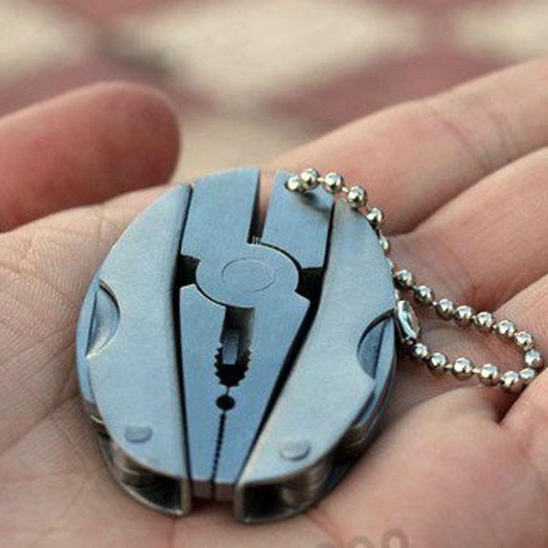 Купить с кэшбэком Multi Pocket Mini Folding Plier Portable Outdoor Hand Tools Wire Cutter Screwdriver Knife Saw Multifunction Survival Keychain