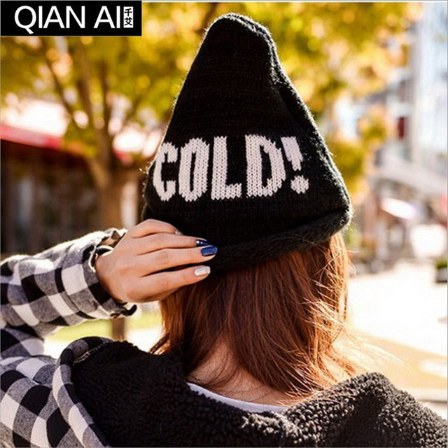 The new winter 2015 bonnet Fashion hat cocked hat letters Warm edge knitted cap