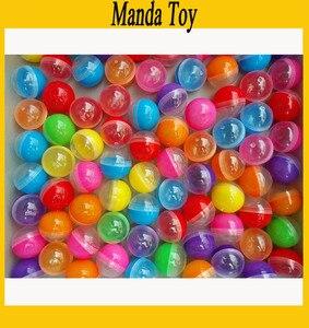 Image 1 - 32mm demi clair demi couleur plastique Capsule jouet Capsules pour la vente vide en plastique jouets balle 100 pcs/Lot livraison gratuite